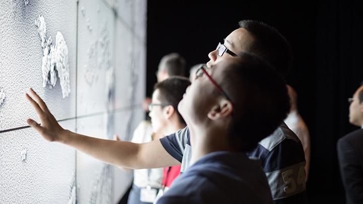 student looking at visual screen