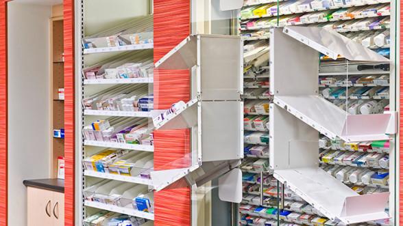 Pharmacy model suite showing multiple shelves of medications